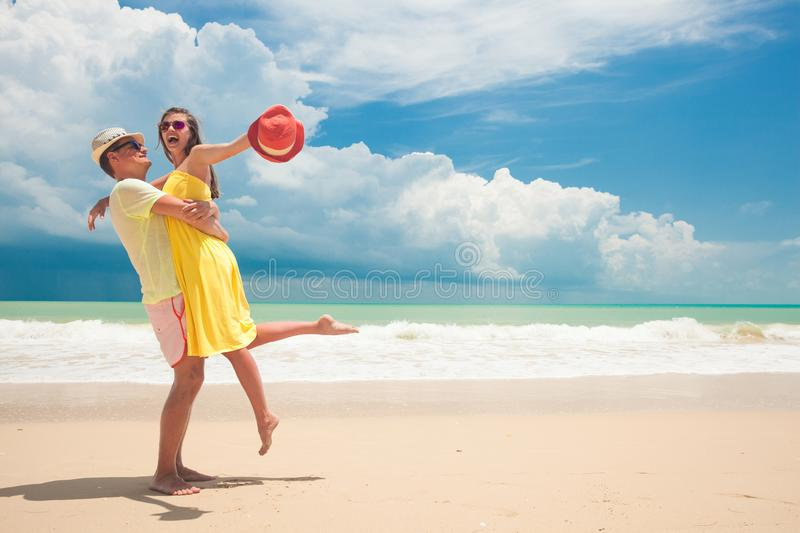 Happy young couple having fun by the beach stock photos