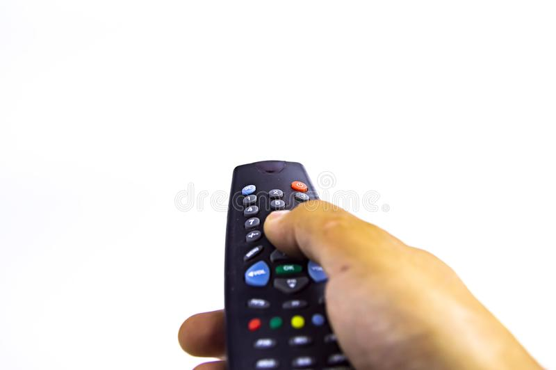 Remote tv remote in man`s hand royalty free stock photography