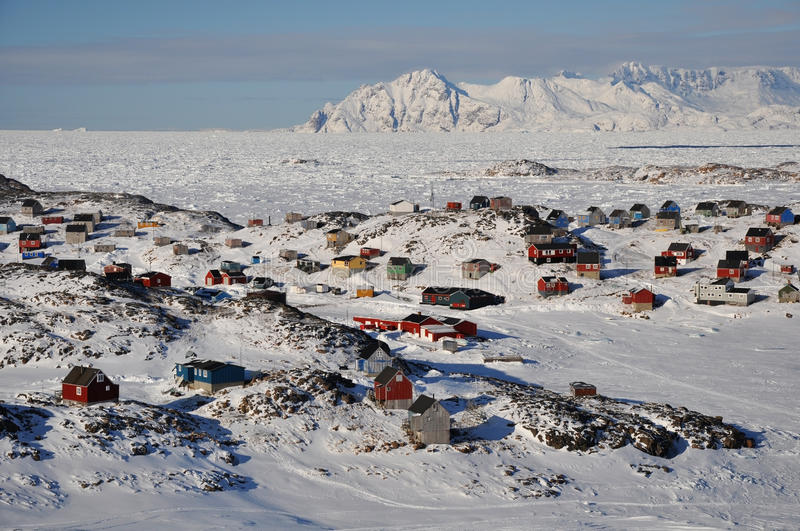 Remote village in winter, Greenland. Houses in the Kulusuk village, Greenland royalty free stock photo