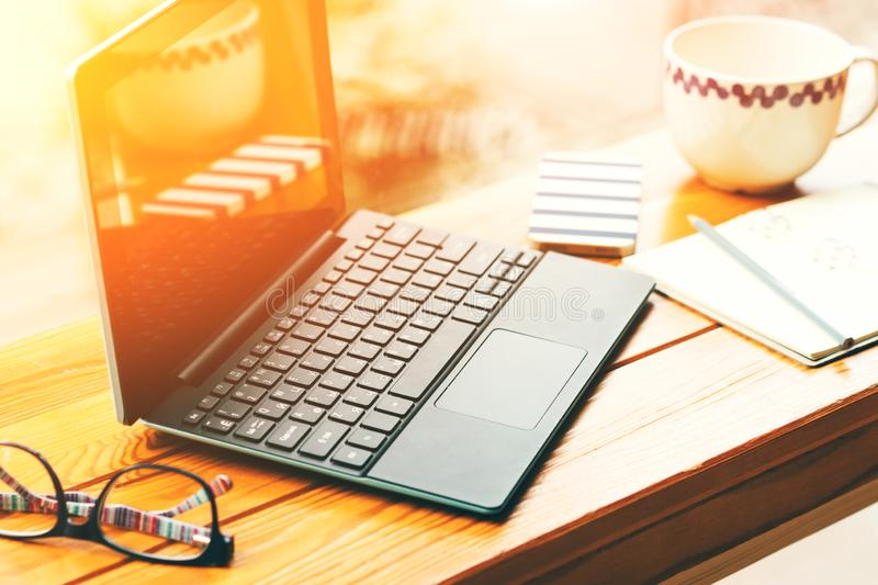 Remote work, working computer equipment on a table in a cafe, student or freelance work place royalty free stock images