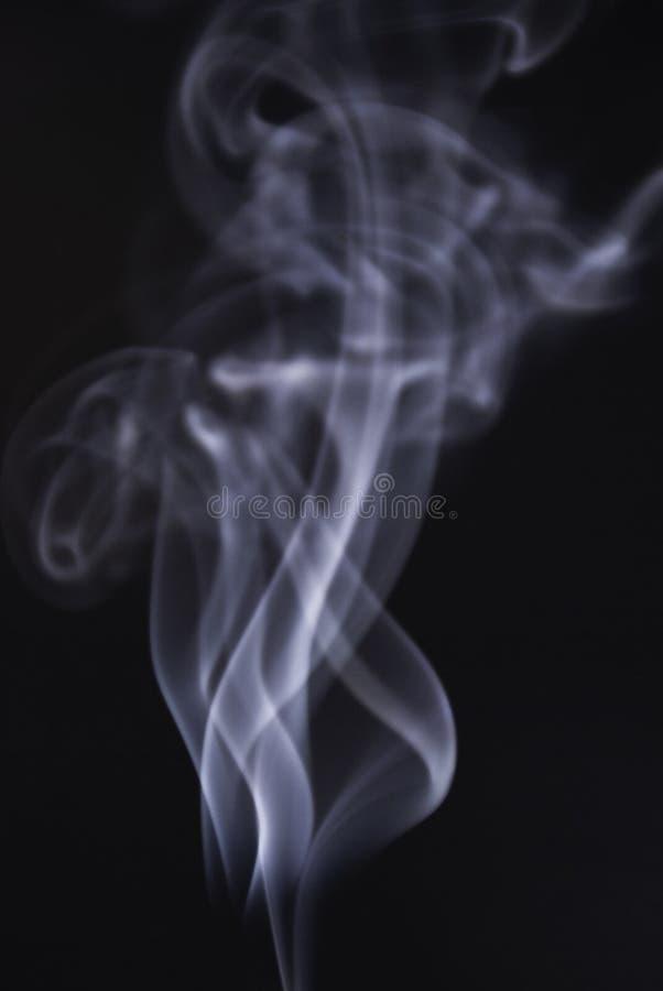Remous et fumée d'art-magie photographie stock libre de droits