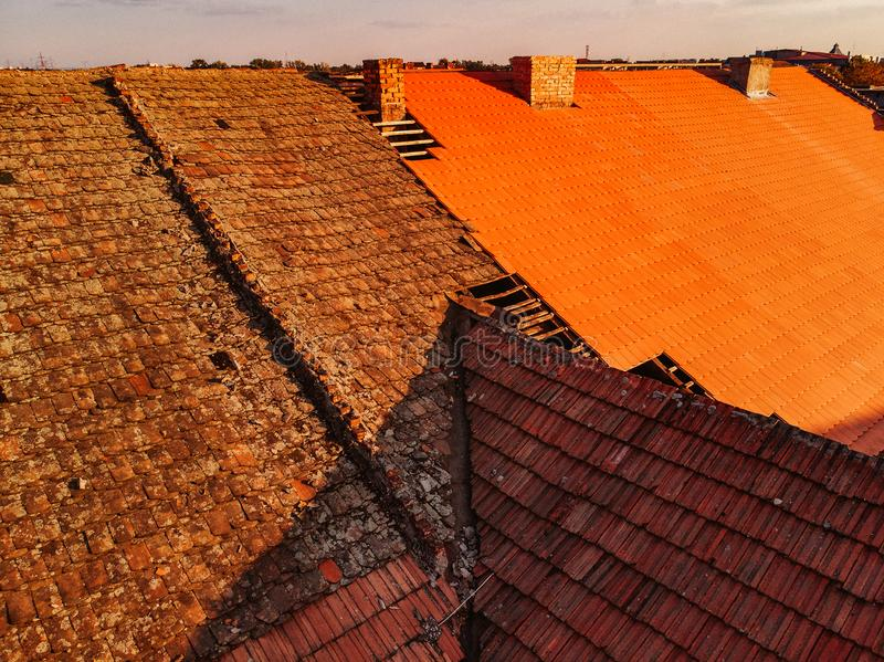 Before and after removal of old roof, replacement with new shing. Le royalty free stock photos