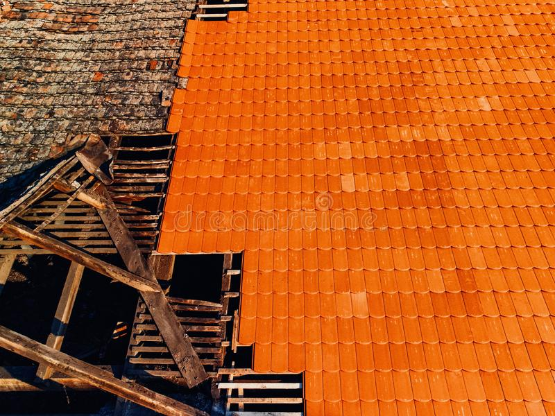 Before and after removal of old roof, replacement with new shing. Le stock image
