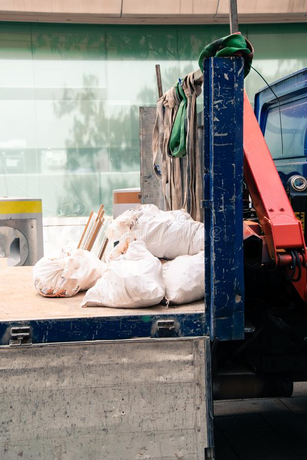 Debris from the work. Removal in a truck of the sacks with debris from a work stock image