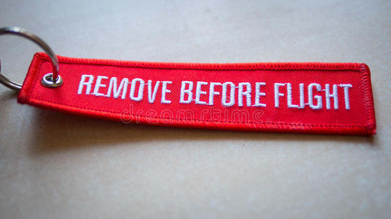 Remove Before Flight Red Tag stock photography