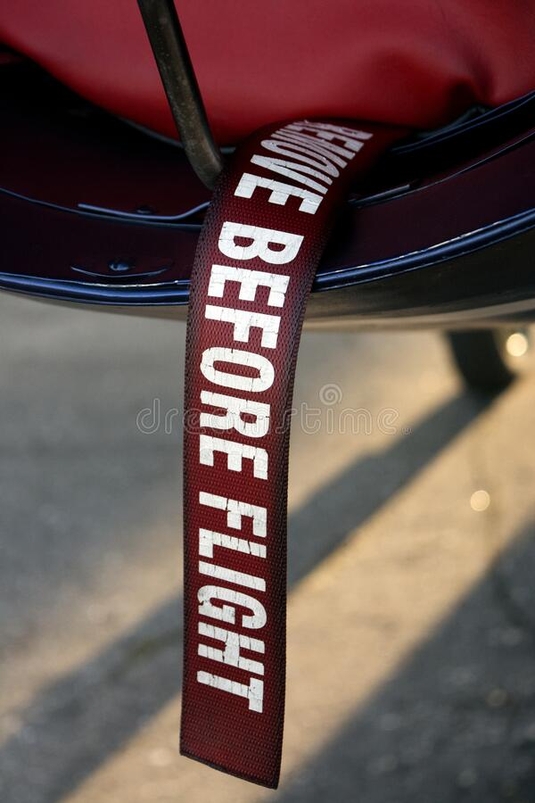 Remove before flight. Remove the red ribbon before flying royalty free stock images