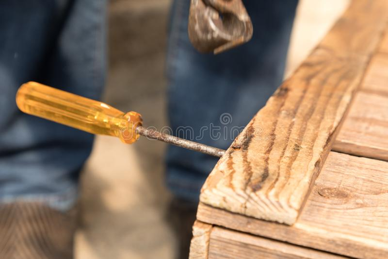 Remove a nail with a pair of pliers stock photo