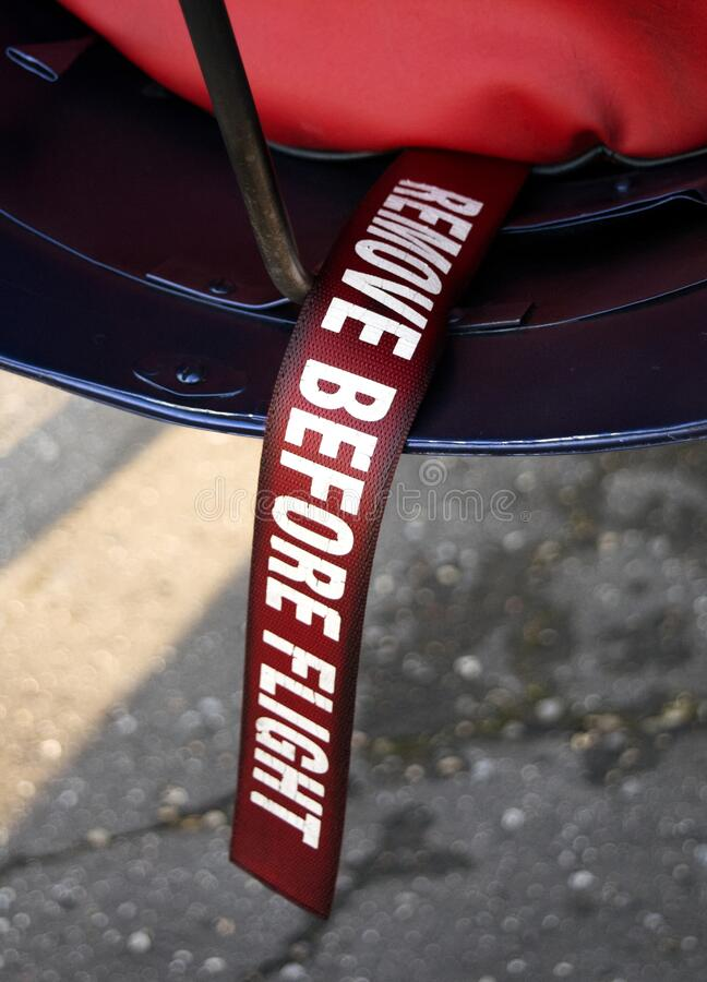 Remove before flying. Remove the ribbon before flying on a plane royalty free stock image