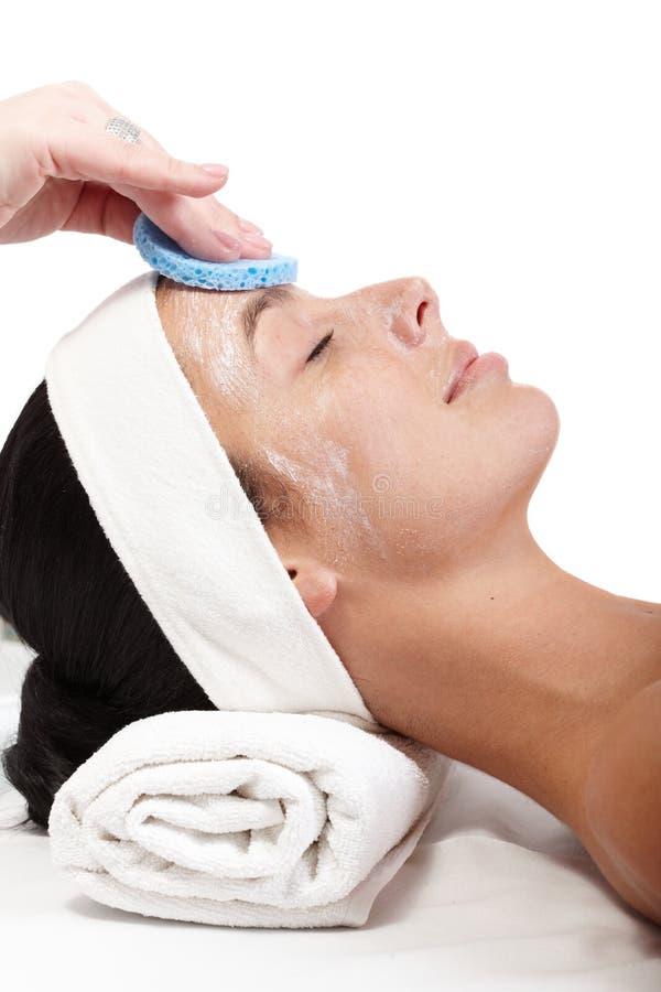 Removendo o creme facial imagens de stock royalty free