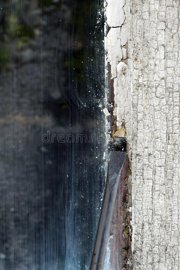 Removing glazing putty from old window. Home renovation concept, vertical close up image with copy space royalty free stock photography