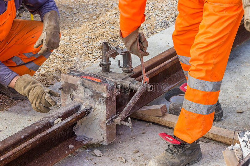 Removing moulds and mould material from the rail stock images