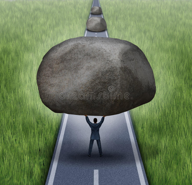 Removing Obstacles. Business concept as a businessman clearing a path to success by removing large rocks from a road that are blocking the journey to success as