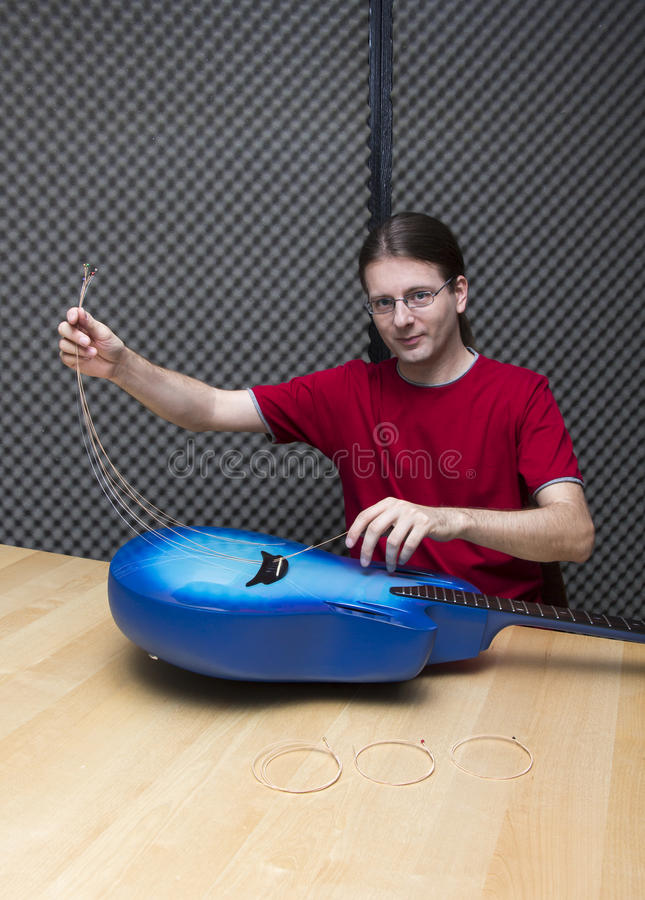 Removing the old guitar strings royalty free stock image