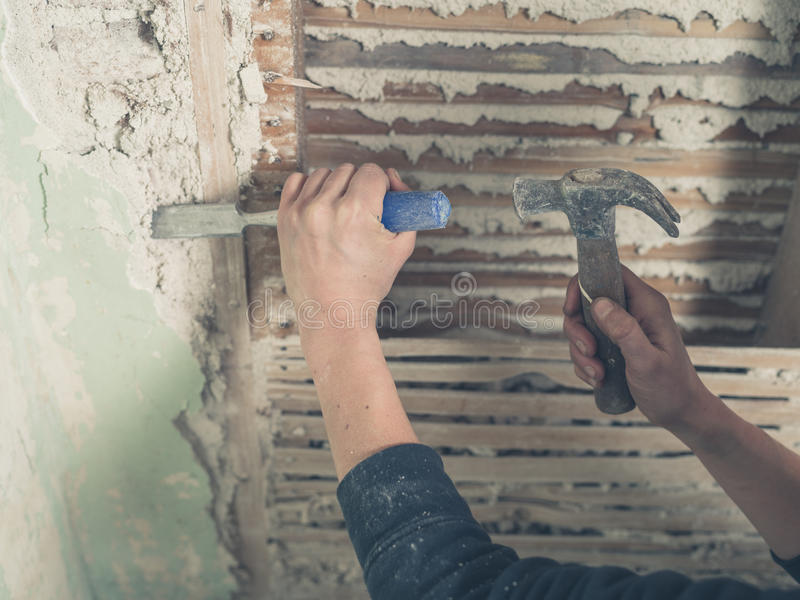 Removing plaster with hammer royalty free stock image