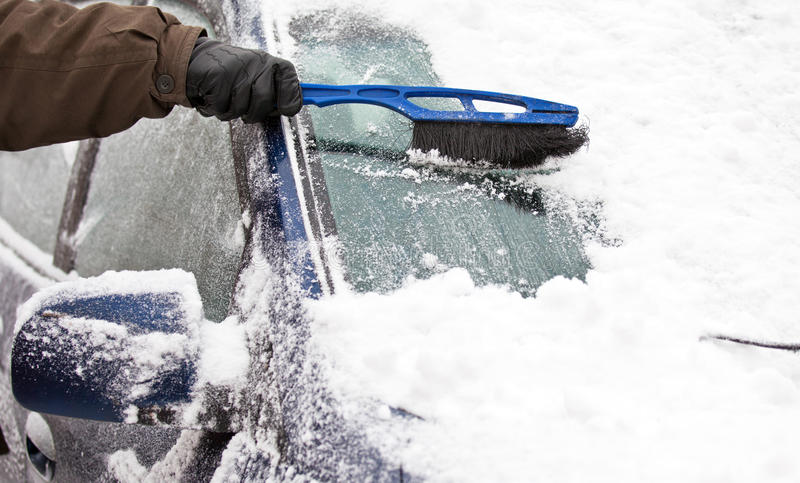 Download Removing snow from car stock image. Image of human, broom - 23098927