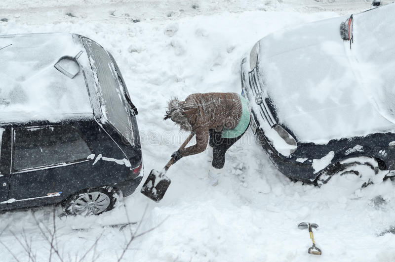 Removing snow from the cars