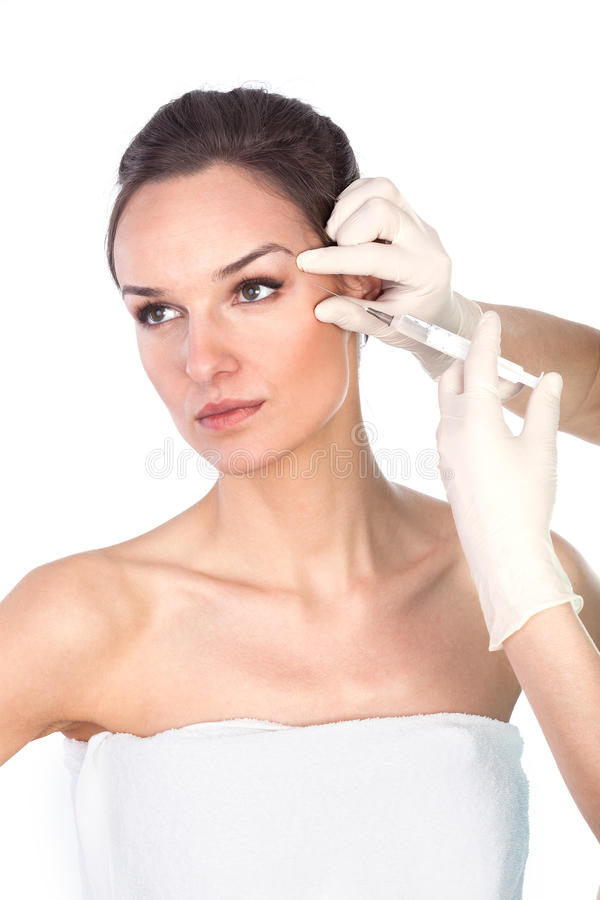 Removing wrinkles around the eyes stock photography
