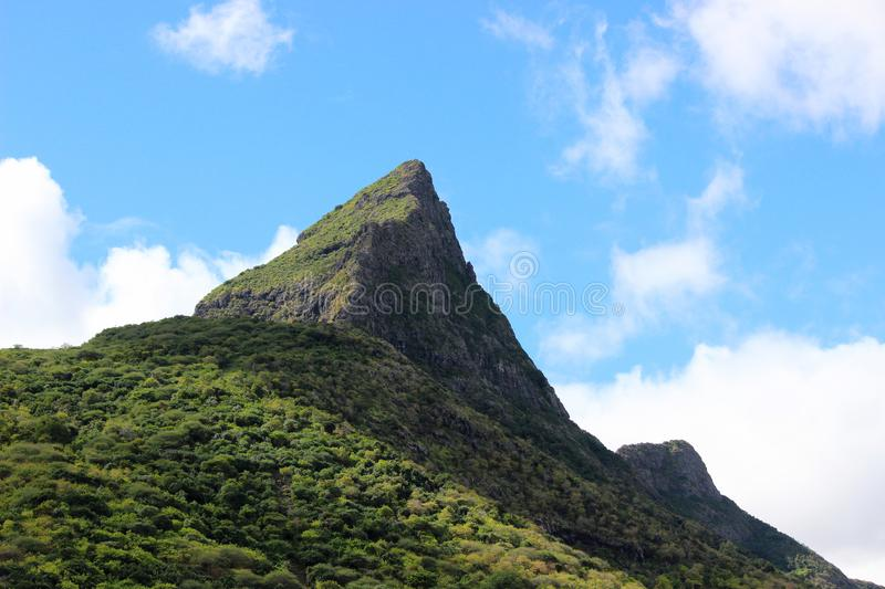 Rempart Mountain, Tamarin, Riviere Noire, Mauritius. Rempart Mountain and sky view, Tamarin, Riviere Noire Mauritius royalty free stock photos