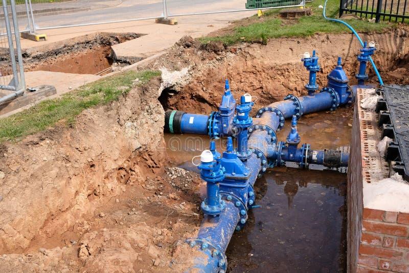 Remplacement de conduite d'eau principale images libres de droits