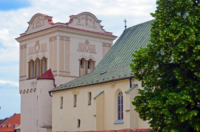 Renaissance bell tower and gothic church in Spisska Sobota, Slovakia. Renaissance bell tower and gothic church in historic old town part of Spisska Sobota royalty free stock photo