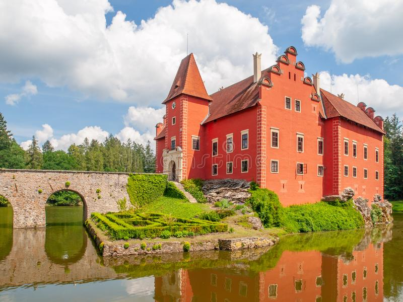 Renaissance chateau Cervena Lhota in Southern Bohemia, Czech Republic. Idyllic and picturesque fairy tale castle on the. Small island reflected in the romantic royalty free stock photo