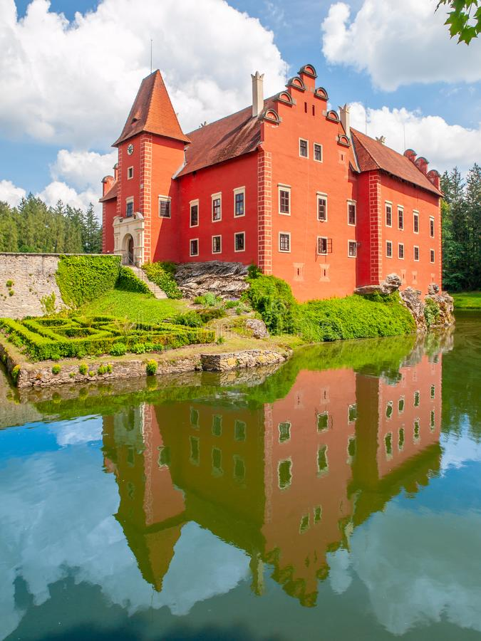 Renaissance chateau Cervena Lhota in Southern Bohemia, Czech Republic. Idyllic and picturesque fairy tale castle on the. Small island reflected in the romantic stock photography