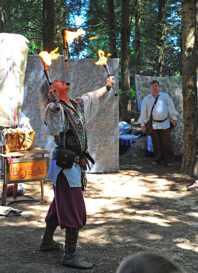 Renaissance fire juggler. Saturday July 23, 2011 Canterbury Renaissance Fayre held this year just off Mount Angel Highway in Silverton Oregon. The juggler royalty free stock image