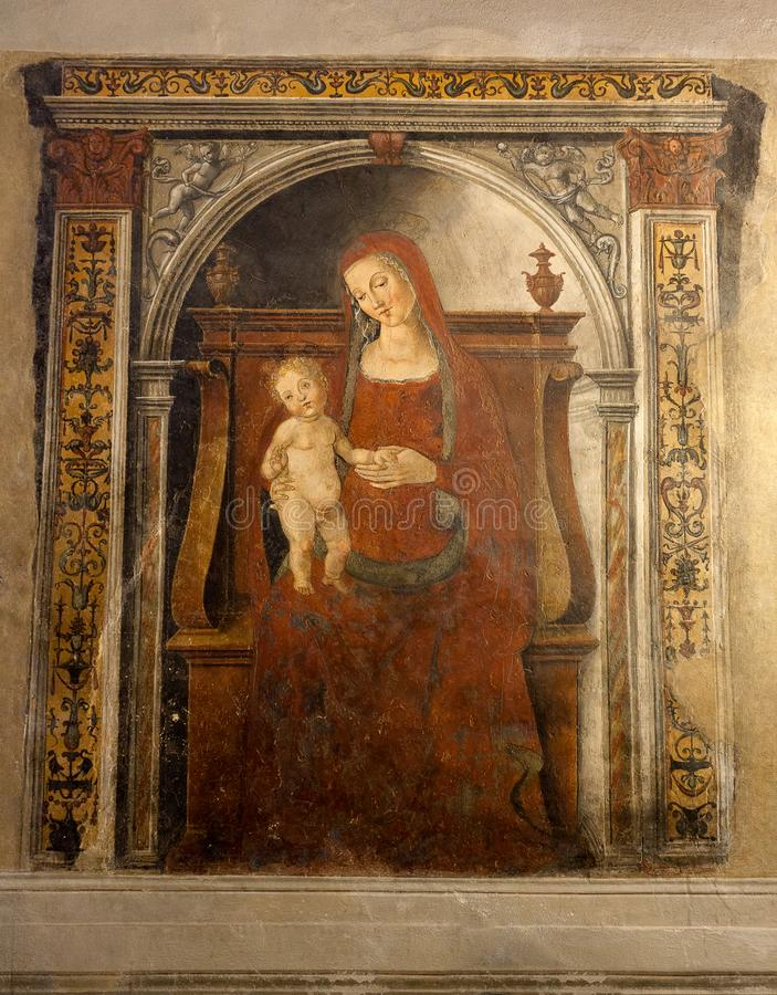 Fresco Holy Virgin Mary child Christ Pubblico, Siena, Italy, night. Renaissance fresco painting of the Holy Virgin Mary with her child Christ in the Palazzo royalty free stock photography
