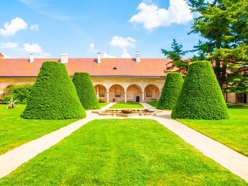 Renaissance internal chateau garden with trim lawn and trees on sunny summer day. Telc, Czech Republic. UNESCO World royalty free stock images