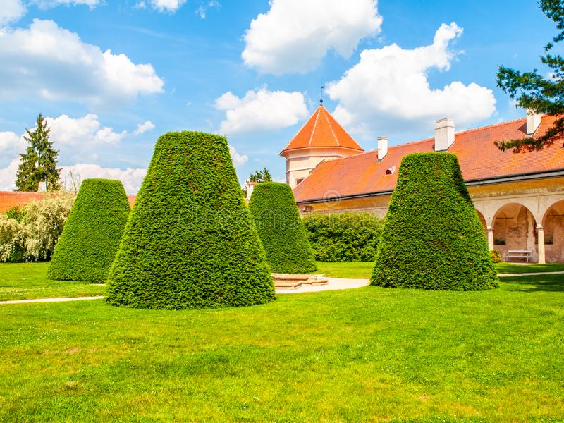 Renaissance internal chateau garden with trim lawn and trees on sunny summer day. Telc, Czech Republic. UNESCO World stock images