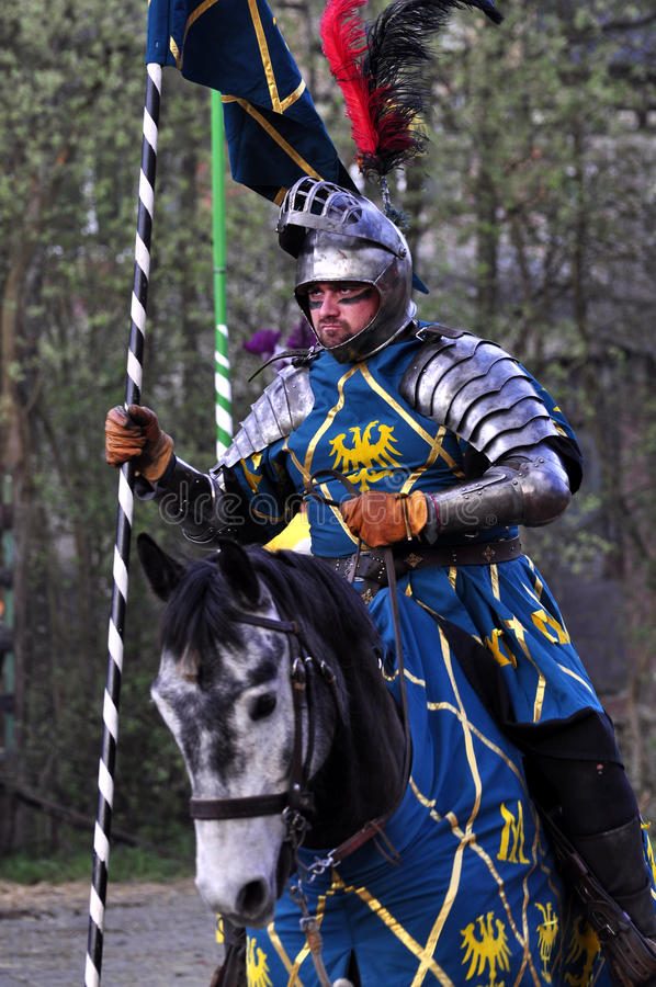 Renaissance knight on horseback stock images
