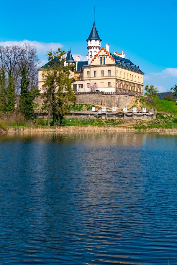 Renaissance old castle Radun near Opava city mirrored in a lake with reflections in water, Czech Republic royalty free stock photos