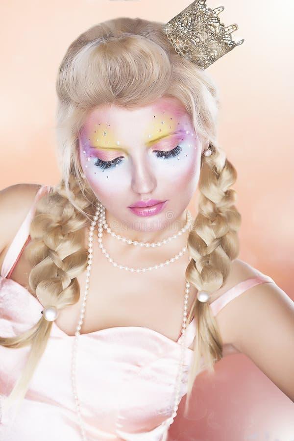 Renaissance. Retro Woman in Golden Crown - Tress. Renaissance - woman in Gold Crown with Blond Tress over Pink stock image