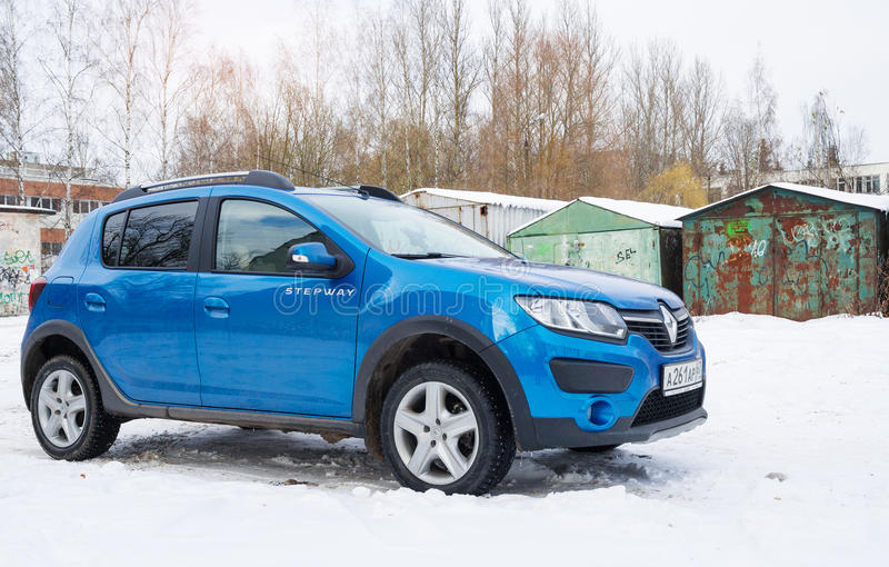 Renault Sandero Stepway parked in winter street. Smolensk, Russia - November 13, 2016: Renault Sandero Stepway parked in winter street stock image