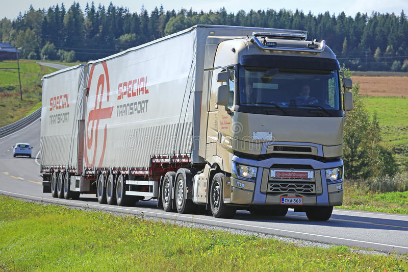 Renault Trucks T and Special Trailer on the Road. SALO, FINLAND - SEPTEMBER 11, 2016: Renault Trucks T and Ahola Special Transport trailer trucking along the stock photos