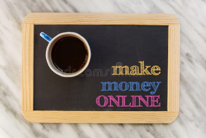 Renda i soldi in linea fotografia stock