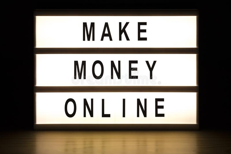 Renda a soldi la scatola leggera online firmare il bordo fotografia stock libera da diritti