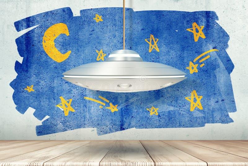 rendu 3d de l'UFO argenté en métal au-dessus du plancher en bois blanc avec le ciel étoilé dessiné sur le mur image libre de droits