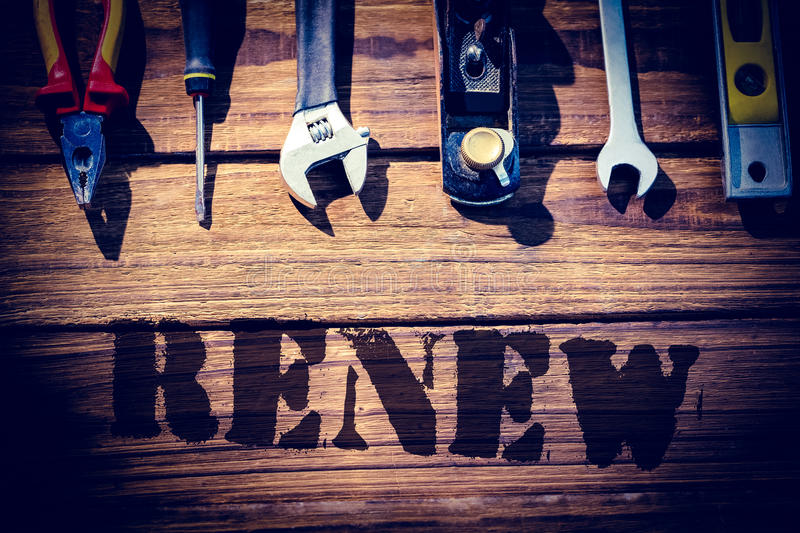 Renew against desk with tools royalty free illustration
