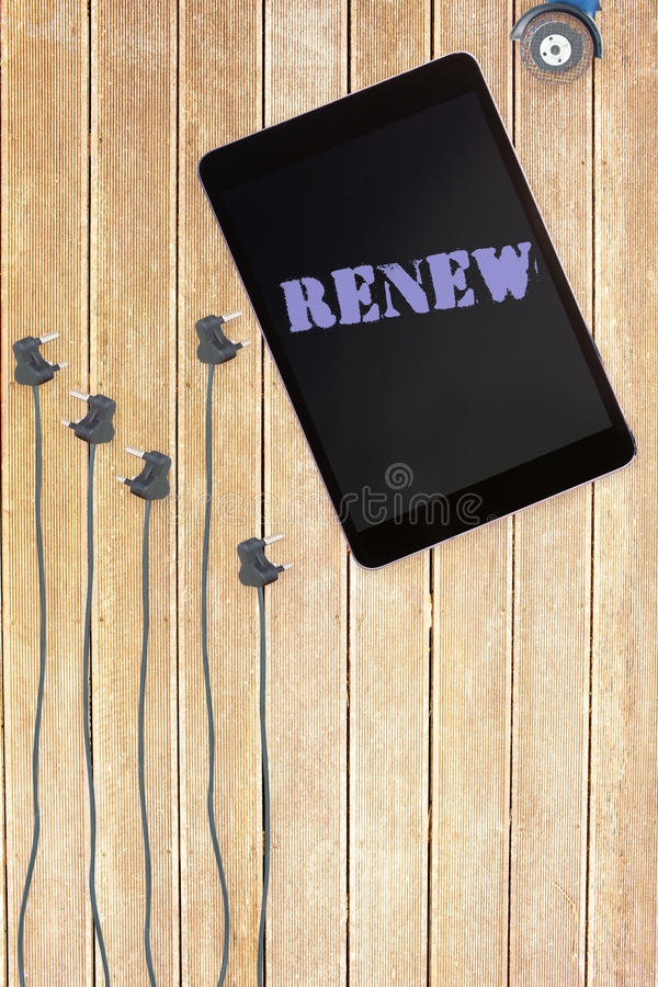 Renew against tablet and plugs on wooden background royalty free illustration
