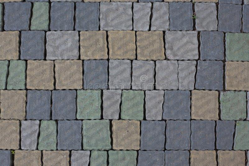 Renew multi-coloriu a pedra que pavimenta a textura Abstraia o fundo estruturado do teste padrão moderno das lajes do pavimento d imagem de stock royalty free