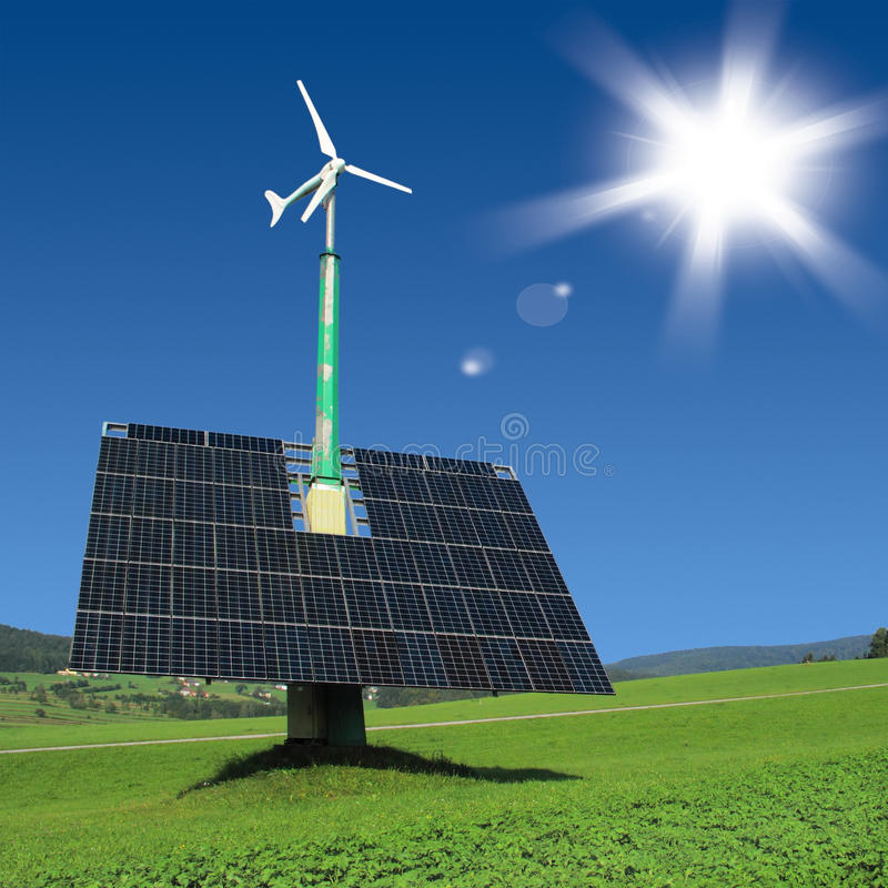 Solar panels with wind turbine stock images