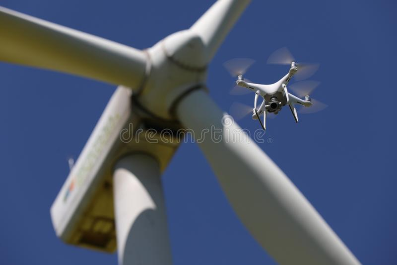 Drone hovering over wind turbines, renewable energy. Renewable energy. Drone hovering over wind turbine. Sky background stock photo
