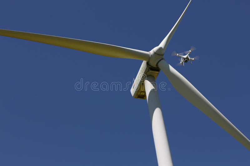 Drone hovering over wind turbines, renewable energy royalty free stock photo