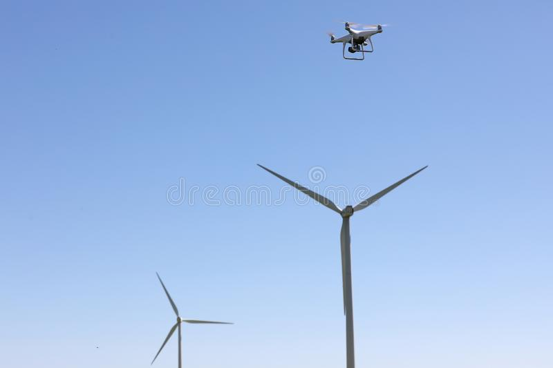 Wind turbines, renewable energy, and drone hovering royalty free stock image