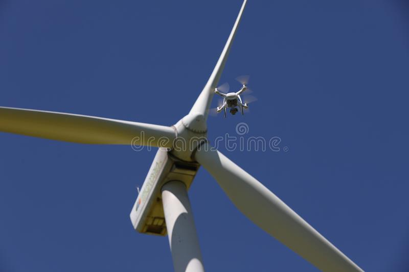 Wind turbines, renewable energy, and drone hovering royalty free stock photos