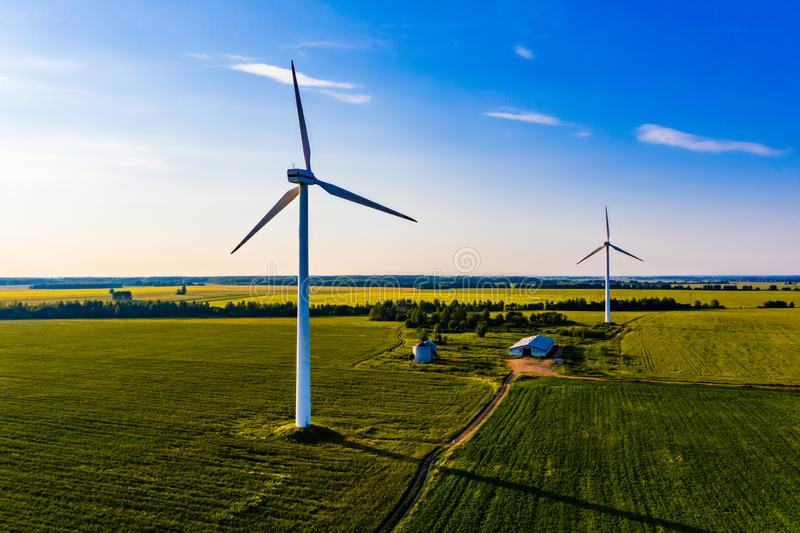 Renewable energy generated in countryside, aerial landscape. Summer time on farm. Renewable energy generated in the countryside, aerial landscape. Summer time on royalty free stock photo