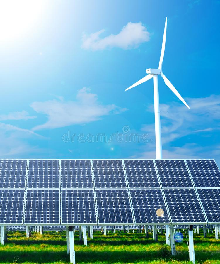 Renewable energy generation - wind turbines and solar plants royalty free stock image