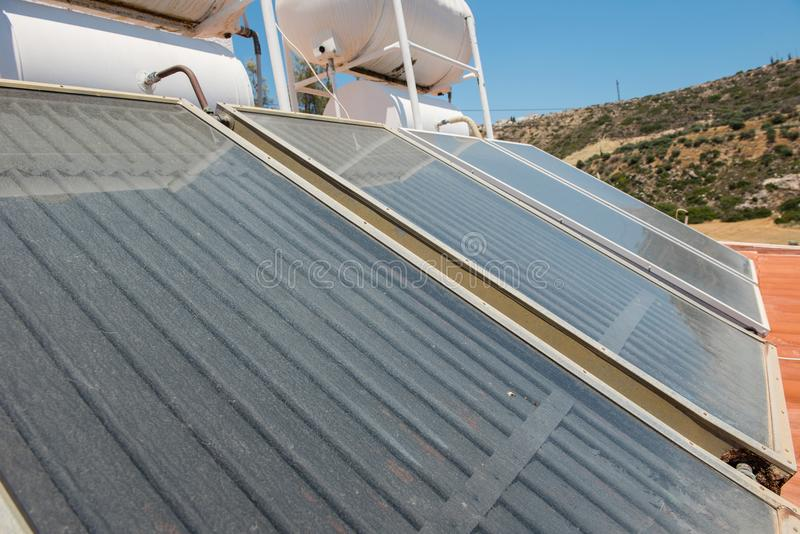 Renewable energy. Solar panel system for hot water stock photos