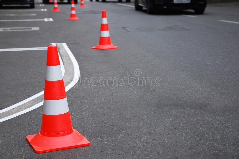 Renewing of parking marking on the road,traffic cones royalty free stock image